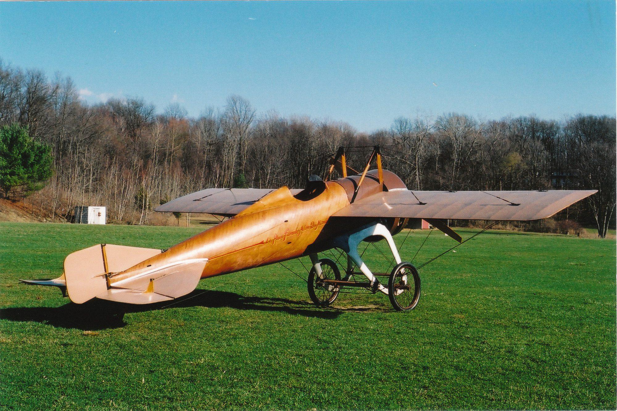 photo of a 1913 Deperdussin Racer in a field